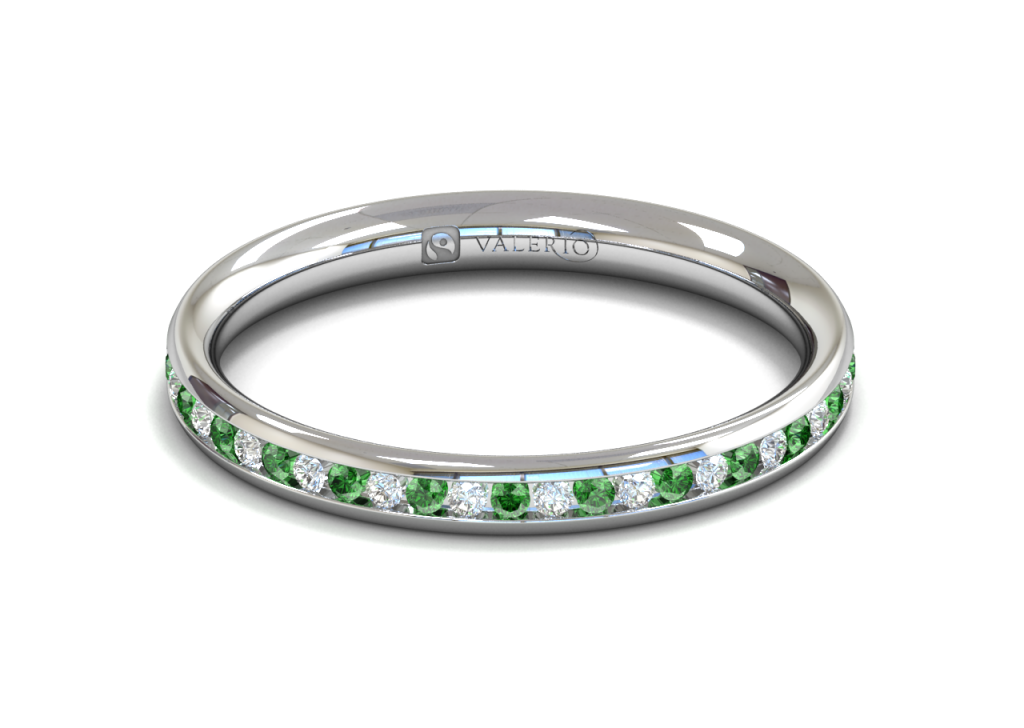 This stunning full diamond and emerald eternity ring is channel set in 18k Fairtrade Gold. Each ring holds approximately forty four 1.5mm round brilliant cut stones from our traceable suppliers. An elegant addition to your engagement ring or maybe you just love stunning colour combinations.