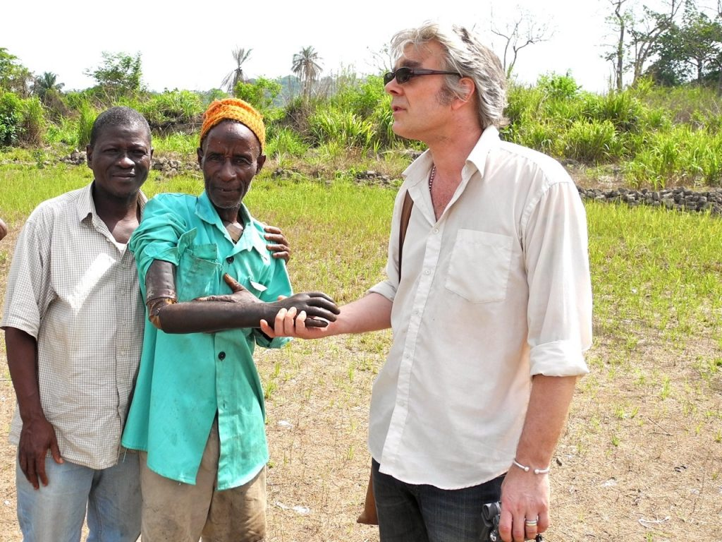 Shaking hands with a victim of conflict diamonds