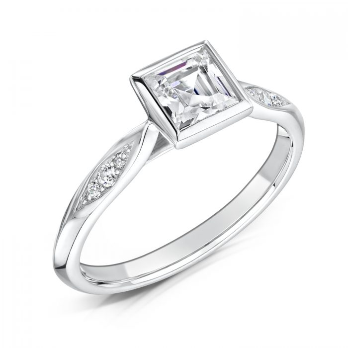Diamond Ring. Princess Cut Centre stone Rubover with diamonds on sides Tilt
