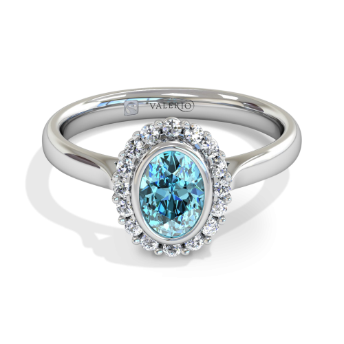 Oval Aquamarine and Diamond Cluster Engagement Ring