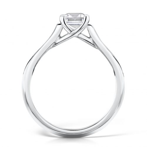 Solitaire Diamond Ring. Princess Cut Centre stone with diamonds on sides